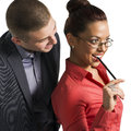 Businessman flirting with a pretty girl worker business men pen glass Stock Photos