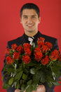 Businessman with flowers Stock Image