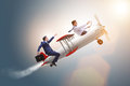 The businessman flying on vintage old airplane Royalty Free Stock Photo