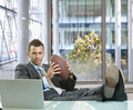 Businessman with football Stock Photos