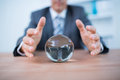 Businessman forecasting a crystal ball Royalty Free Stock Photo