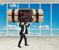 Businessman in formal wear carrying big bomb Royalty Free Stock Photo