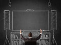 Businessman in front of a home cinema system young sitting and enjoying sketched on chalkboard Royalty Free Stock Image