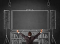 Businessman in front of a home cinema system young standing and enjoying sketched on chalkboard Royalty Free Stock Photo