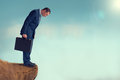Businessman gap worry fear obstacle standing on a cliff edge Royalty Free Stock Photos