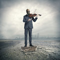 Businessman with gas mask, plays the violin Royalty Free Stock Photo