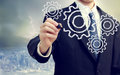 Businessman with gears concepts of teamwork efficiency interlocking parts Royalty Free Stock Image