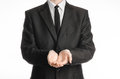 Businessman and gesture topic a man in a black suit with a tie folded his hands in front of him isolated on a white background in Stock Photography