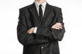 Businessman and gesture topic a man in a black suit with a tie folded his hands in front of him isolated on a white background in Stock Image