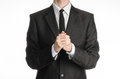 Businessman and gesture topic: a man in a black suit with a tie folded his hands in front of him and praying, meditating businessm Royalty Free Stock Photo