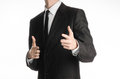 Businessman and gesture topic a man in a black suit with a tie showing a sign on your hands on an isolated white background in st Royalty Free Stock Photo