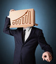 Businessman gesturing with a cardboard box on his head with diag standing and diagram Stock Photos