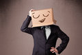 Businessman gesturing with a cardboard box on his head with smil standing and smiley face Royalty Free Stock Images
