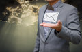 Businessman get email in hand with shiny sky Royalty Free Stock Photo