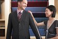 Businessman Getting Measured By Female Tailor Stock Images