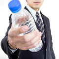 Businessman give you water for drink in studio Royalty Free Stock Photography