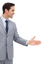 Businessman giving his hand against white background Royalty Free Stock Images