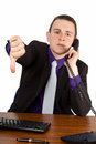 Businessman giving refusal young on the phone showing thumbs down isolated Royalty Free Stock Image