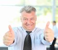 Businessman giving you thumbs up Stock Image