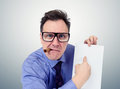Businessman in glasses holding a paper. Royalty Free Stock Photo