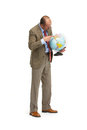 The businessman with the globe on a white background Stock Images