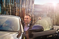 Businessman going out of the car Royalty Free Stock Photo
