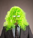 Businessman with a green wig long hair Royalty Free Stock Photography