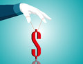 Businessman hand controlling dollar