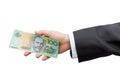 Businessman hand holding Australian dollars (AUD) on isolated ba Royalty Free Stock Photo