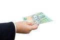 Businessman hand holding Australian dollars (AUD) Royalty Free Stock Photo
