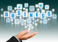 Businessman hand holding with business alphabet st Stock Image