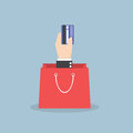 Businessman hand holding credit card with shopping bag Royalty Free Stock Photo