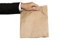 Businessman hand holding(Sharing,giving) brown paper bag lunch, isolated on white background Royalty Free Stock Photo