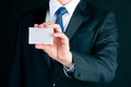 Businessman hand over business card man or manager in suit empty to socialize Royalty Free Stock Image