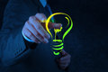 Businessman hand with a pen drawing light bulb Royalty Free Stock Photo