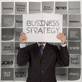 Businessman hand show book of business stragtegy Stock Photos