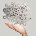 Businessman hand showing gears cogs to success concept Royalty Free Stock Image