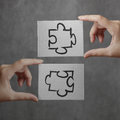 Businessman hand showing  puzzle partnership sign Royalty Free Stock Photo
