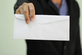A businessman handing in a blank envelope Royalty Free Stock Photo