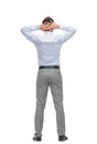 Businessman with hands behind his head from back business people rear view and office concept Stock Photo