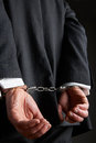 Businessman With Hands Cuffed Behind Back Royalty Free Stock Photo