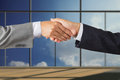 Businessman handshake business people handshaking on background of modern office Stock Photo