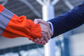 Businessman handshaking with worker. Handshake of suit and boile Royalty Free Stock Photo