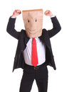 Businessman with happy businessman with a paper bag with smile on head paper bag on head dancing isolated white Stock Photo