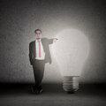 Businessman has bright idea standing bright light bulb Stock Photos