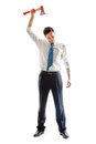 Businessman with hatchet a young standing Stock Photo