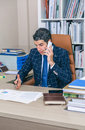 Businessman having discussion by phone in office Royalty Free Stock Photo