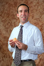 Businessman Having Orange For Snack Royalty Free Stock Photos
