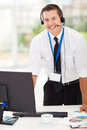 Businessman with headphones handsome in office Royalty Free Stock Photography