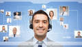 Businessman in headset over contacts icons business people technology communication and service concept smiling and on virtual Royalty Free Stock Image